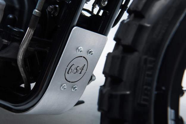 A 2010 Triumph Bonneville given the hardcore scrambler treatment by 6/5/4 Motors.